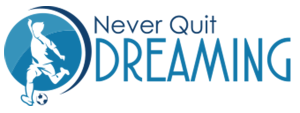 Never Quit Dreaming Logo: Kid about to kick a soccer ball.