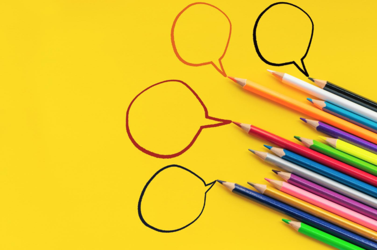 Color pencils with comment bubbles to indicate communication and engagement