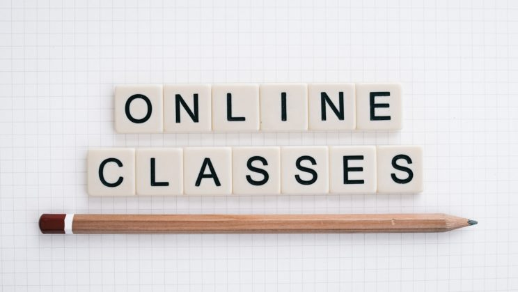 Online learning in block letters with a pencil underlining the text
