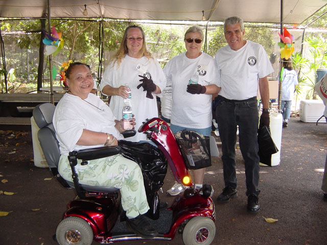 APPLAUD Event: four people, where one person is in an electric wheelchair