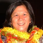 Alison Lee with many lei around her neck.