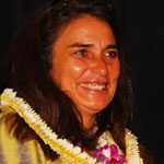 Charmaine Crockett smiling with a lei on.