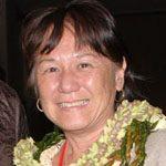 Velina Sugiyama smiling with lei around her neck.